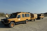 Eco Tur Land Cruiser - 9 seaters and trailer en route Lucira.jpg