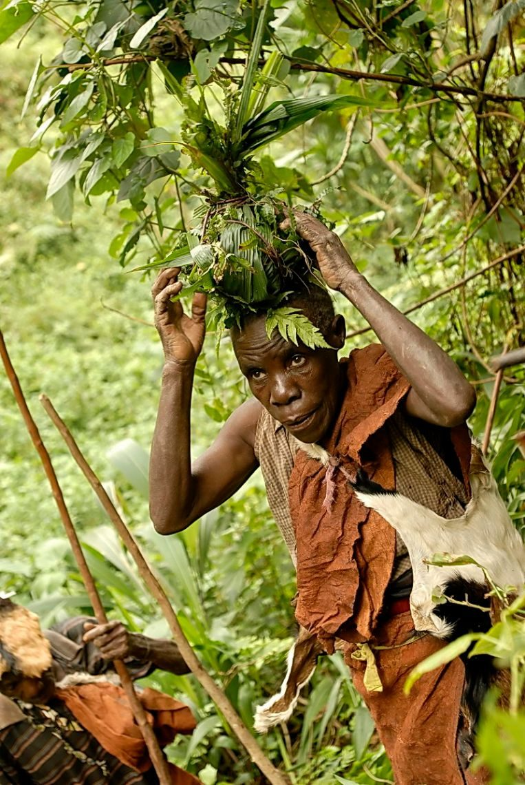 After-food-gathering-an-elderly-woman-returns-home-to-prepare-food.-Source_-Batwa-Experience.jpg
